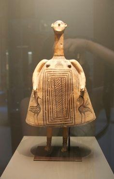 """It's an ancient Greek 'plagona' doll of the geometric period"""""""