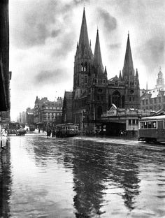 St Paul's Cathedral, cnr Swanston and Flinders Sts. Melbourne Australia on a bleak day ~1949. (with the now demolished Princes Bridge Station on the right - Site of Federation Square)