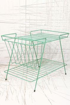 Green Magazine Rack from Urban Oufitters, a little pricey at £80, but gorgeous!
