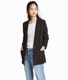 Black. Single-breasted blazer in woven, crêped fabric. Notched lapels, front pockets, and a snap fastener at front. Unlined.