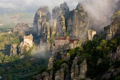 "The monasteries of Meteora rise out of the emerald valley on pillars of sandstone to touch the sky. In Greek, Meteora means ""the middle of the sky,"" ""suspended in the air,"" or ""in the heavens above,"" and the name almost says it all! Six monasteries are built on different pillars in the Pindus Mountains of Greece. Monks and nuns still work in the monasteries today, but they are also open to tourists, so take a drive into the valley and up the winding road to visit the exotic monasteries for…"