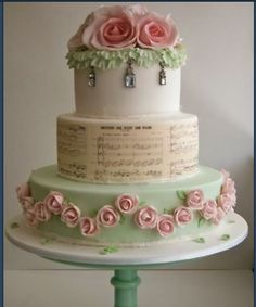 Shabby chic cake -  Lovely idea of putting the sheet music on the middle layer.  The crystals on the top are a nice touch.   ᘡղᘠ