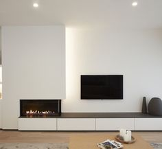 Gas fire to one side (not TV above). Other idea is couch facing TV and fire to the side