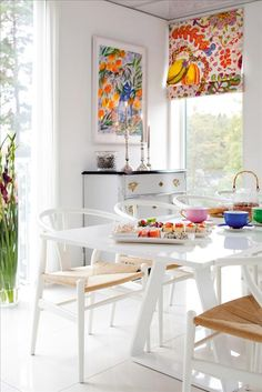 dining room with colorful Josef Frank roman blinds