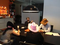 Just having a status meeting, with our status hats.