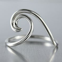 Organic in design this sterling silver wave ring is popular among nautical enthusiasts, surfers and beach goers. A lover of the ocean myself