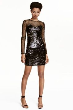Short dress in sequin-embroidered mesh with transparent yoke, sleeves and sections at the waist. Concealed zip in the side and an opening with a button at t