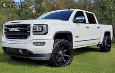 149965 1 2016 sierra 1500 gmc leveling kit fuel coupler machined accents slightly aggressive.jpg