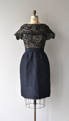 Vintage 1950s black lace illusion bodice cocktail dress with cape-like collar, fitted waist and metal back zipper. --- M E A S U R E M E N T S ---