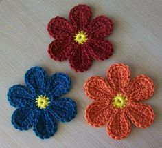 Free flower pattern on Crochetville's social community message board site: http://www.crochetville.com/community/topic/99707-colorful-yarn-flower/
