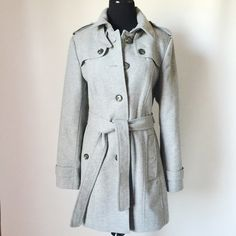 """Banana Republic Trench Coat Banana Republic Trench Coat in gray featuring classic structured detail.  Heavy cold weather coat, fully lined inside.  Pre-loved but in excellent condition.  Small stain on inside, see pic. No other holes, tears or signs of wear.  Measurements laying flat: Armpit to armpit: 20"""" Waist (across): 18"""" Total length: 33.5"""" (approx.) Sleeve length: 25"""" Banana Republic Jackets & Coats Trench Coats"""