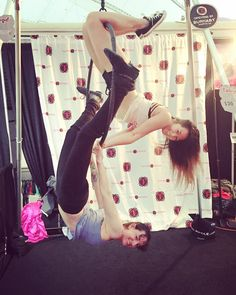 """""""You never know what crazy stunts you'll see at the @tantrafitness #taboo2016 booth right across from the main stage! Check out our #aerialhoop and #pole…"""""""