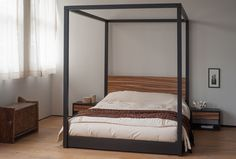 A stunning bed with a black stained, solid oak frame and a headboard in exotic zebrano wood. Made in the UK by craftsmen. Four Poster Bed Frame, 4 Poster Beds, Cube Table, Bed Company, Drawer Table, Garden Bedroom, Table Frame, Awesome Bedrooms, Contemporary Decor
