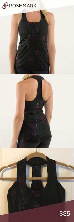 "Lululemon Midnight Iris Multi/Black Scoop Neck Lululemon Scoop Neck Tank Midnight Iris Multi / Black Release Date: 8/2013 Style Number: W1544S Original Price: $58 Material: Luon, COOLMAX ""For those of us blessed with a spoonful up top (maybe even double and triple scoops) who still want to sport a strappy tank for yoga, we designed the Scoop Neck Tank. The wide straps and scoop neck cut give us bust support and coverage."" Excellent like new condition. No rip tag but measures 14"" across…"