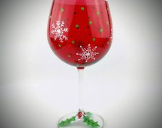 Christmas wine glasses, hand painted red wine glasses with snowflakes and holly, Christmas decorated Glitter Glasses, Red Wine Glasses, Hand Painted Wine Glasses, Diy Christmas Wine Glasses, Wine Glass Crafts, Wine Glass Set, Glass Bottle, Diy Bottle, Wine Gifts