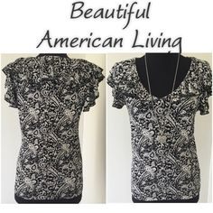 """American Living top. Black and gray American Living blouse.  Ruffle around neckline and sleeve is so pretty. Stretchy. 17"""" under arm-under arm.  24"""" from shoulder to hem.  Very good condition. Tops Blouses"""