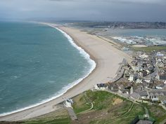 Chesil Beach - a barrier beach that has formed parallel to the coast and connects the isle of Portland to the mainland! SO COOL! I want to walk along it.