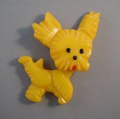 Shultz bakelite yellow dog brooch, trembler head