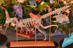An origami T.rex on the 2014 Origami Holiday Tree.