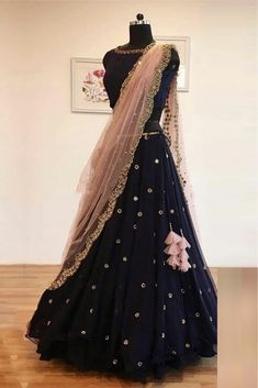 Black Colour Net A Line Lehenga Choli Comes With Matching Silk Blouse Fabric. This Lehenga Choli Is Crafted With Embroidery,Lace Work. This Lehenga Choli Is Semi Stitched and Blouse Comes As a Unstitc. Net Lehenga, Lehenga Choli, Anarkali, Indian Lehenga, Sweat Shirt, Hairstyles For Gowns, Indian Hairstyles, Floral Skirt Outfits, Bridal Lehenga Online