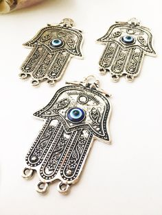 A personal favourite from my Etsy shop https://www.etsy.com/listing/539882251/hamsa-evil-eye-charm-bohemian-necklace Hamsa evil eye charm, bohemian necklace charm, DIY jewelry making charm, hamsa hand pendant, silver hand of fatima charm, necklace pendant #hamsahand #hamsacharm #silverhamsa #evileye #evileyes #hamsahandpendant #diy