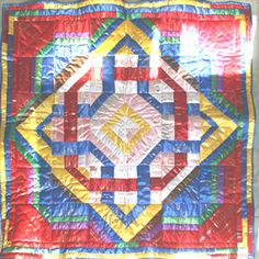 Finally starting to give into the idea of making a ribbon quilt out of Mare's ribbons.  Love this celtic knot design.