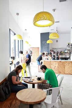 Boja pendant lights from Ikea, spray painted with a high gloss bright yellow paint at an auto body shop.