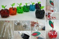 Manzanas de colores con botellas de refrescos