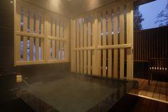 Tiled bath outside.