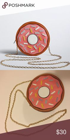 """Donut Purse 🍩 Good enough to eat! A donut-shaped crossbody bag pops with pink faux leather frosting and multi-color """"sprinkles."""" A sweet treat, especially once you catch a glimpse of the removable gold tone chain. Strap length: 7"""" torrid Bags Crossbody Bags"""