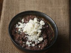 Spicy Black Bean Dip with Cotija Cheese | Salty cotija cheese is the perfect topping for this kicked up black bean dip.
