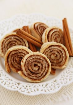 """Piecrust Pinwheel Cookies - Super easy, just roll out a Pie Crust on a sheet pan, butter Crust generously, top with Cinnamon and Sugar, roll up into a tube shape, and chill for a couple of hours. Cut into thin cookies with a sharp knife and bake. Delicious! TIP: You can use a store-bought Pie Crust, but they won't be as flaky.  Great for when the kids say, """"Oh, yeah, I need 3 dozen cookies tomorrow."""" ~~ Houston Foodlovers Book Club"""