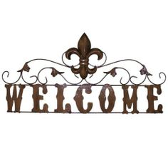 """LL Home Metal Welcome Sign with Fleur De Lis by LL Home. $29.99. Welcome sign with Fleur De Lis. Powder coated metal for rust resistance. Brushed brass color. Sign is 3/4"""" spaced from wall. Indoor or outdoor use. Metal sign says """"Welcome"""" with a Fleur De Lis on top center. Scrolls with leaves spread across the top of the word.. Save 33% Off!"""