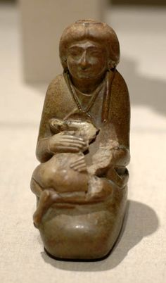 Glazed bottle of a mother and child, 18th Dynasty, reign of Tutankhamun or Horemheb. These bottles were made throughout the 18th Dynasty but their use isn't clear. They could be for holding mother's milk - medical texts mention that this is a remedy for some ailments (male child). Ancient Egypt
