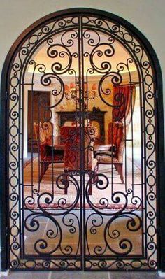 Wrought iron doors are indeed a style from the past. With creativity, you can make your house look more sophisticated with the wrought iron front doors. Gate Design, Door Design, House Design, Wrought Iron Decor, Wrought Iron Gates, Tuscan Decorating, Iron Art, Iron Doors, Windows And Doors