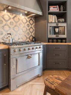 How to make a statement - LOVE this backsplash! Kitchen Cabinet Color Options: Ideas From Top Designers on HGTV #staging #kitchen love it @Wendy Felts Werley-Williams. liked@ www.stagedtodaysoldtomorrow.com