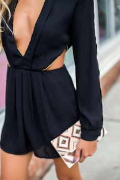 Gold accents on this sexy, deep v black romper gets us in the mood for a nighttime rendevous! -Lined