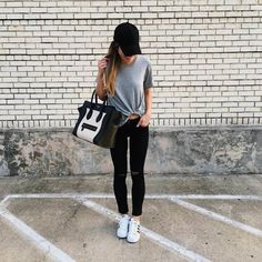brighton wearing distressed black jeans and adidas with grey t-shirt, celine, black baseball cap, adidas superstars, travel outfit, black jeans and grey tee