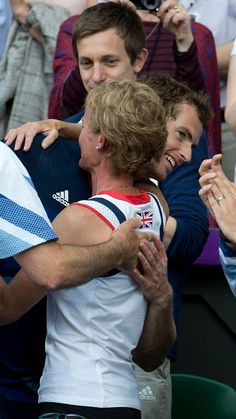 Hugs for champ Andy Murray from mum Judy