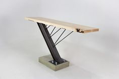 A custom table made of maple, steel, and concrete. Donated to Montana State University for the Celebration of Architecture Berkas, Zach George, Taylor Proctor. Welded Furniture, Iron Furniture, Steel Furniture, Modern Furniture, Furniture Design, Furniture Gliders, Industrial Style Furniture, Industrial Table, Wood Steel