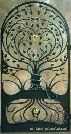 gorgeous metal garden gate with tree design