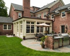 Patio and Outdoor Kitchen at a Classic Scarsdale Brick Colonial | Fivecat Studio Architecture and Construction | Architects serving Westchester County, NY