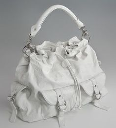 Need an oversize purse in black. Hard to find with all the outside pockets. This seems pretty good