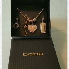 BeBe Logo 3x Charm Necklace Cute, and stylish Gold necklace with 3 Bling interchangeable charms. *Firm Price*. Thank you and Happy Poshing!!!! bebe Jewelry Necklaces