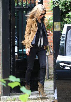 Kate Moss added major bohemian-cool flair to her London look via a tan fringe jacket.