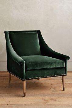 Sexy, swoop arm armchair in deep emerald/forest green velvet.