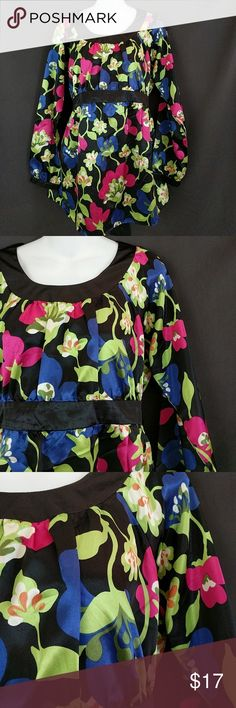 """Motherhood Maternity Floral Tie Back Top Bright floral silk feel maternity top. Beautiful! There is a small snag on a blue flower on the backside in the 5th picture. Hardly noticeable. Motherhood Maternity brand. 100% polyester. Smoke free. Excellent condition. Measurements are flat lay and the best way to determine proper sizing. Chest across at armpits 19"""". Waist at belted area, untied 18"""". Bottom hem 23-1/2"""". Length from shoulder 29"""". Sleeve from neck 26"""" . GT2 Motherhood Maternity Tops…"""