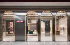 Chinese practice Xian Xiang Design uses a lot of stainless steel to design a futuristic interior for the new Wellsky store in Hangzhou, China. Retail Interior Design, Retail Store Design, Retail Shop, Retail News, Retail Facade, Shop Facade, Jewelry Store Design, Jewelry Shop, Restaurants
