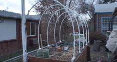 How To Make A Retractable PVC Hoop Greenhouse For A Raised Bed Garden - http://www.homesteadingfreedom.com/how-to-make-a-retractable-pvc-hoop-greenhouse-for-a-raised-bed-garden/
