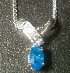 Neon blue apatite and white sapphire sterling silver pendant